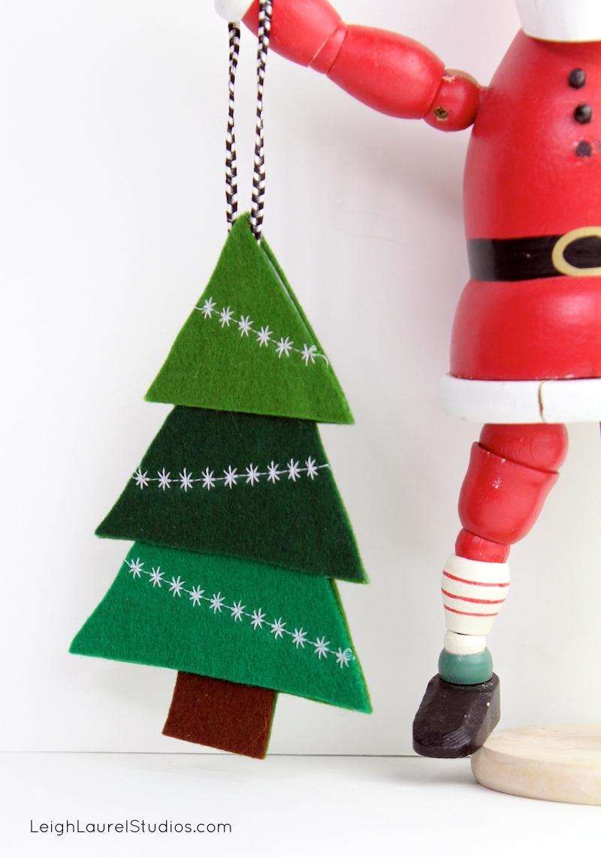 Santa holding tree