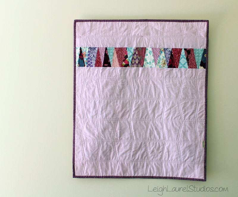 Scrappy back of baby tumbler quilt in pinks purple and teal by karin jordan - leigh laurel