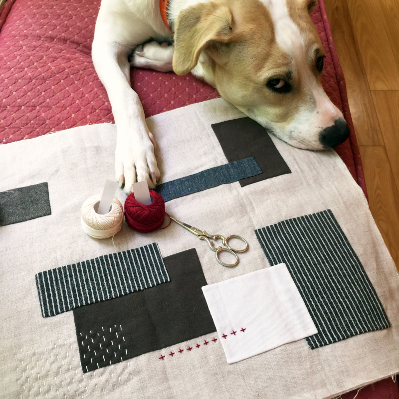 Improv applique table runner with unimpressed helper