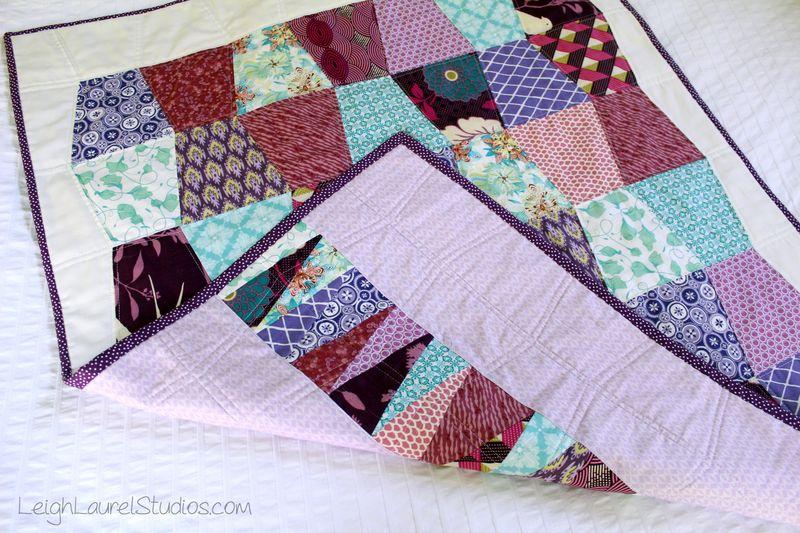 Scrappy baby tumbler quilt by karin jordan of leigh laurel