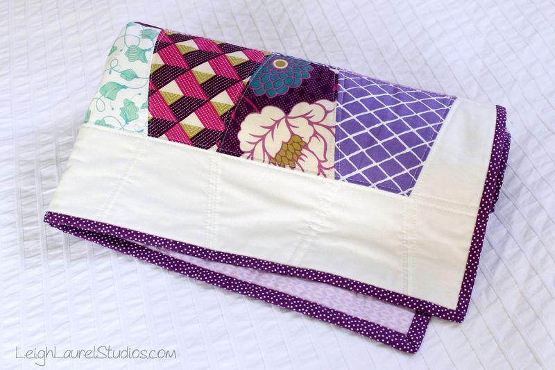 Rolled up baby tumbler quilt by karin jordan