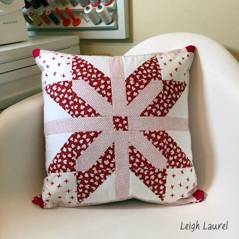 Emblem pillow by karin jordan