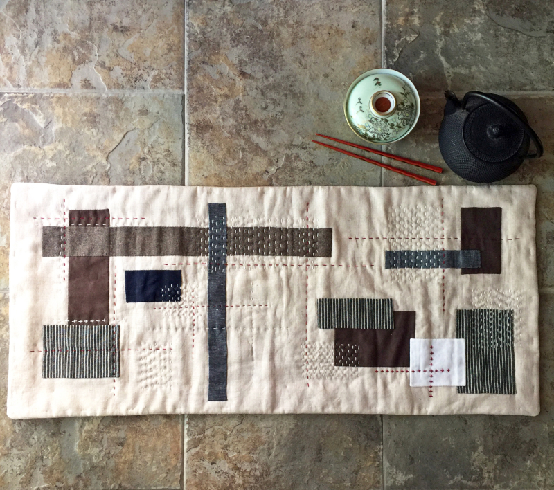 Improv applique table runner by karin jordan